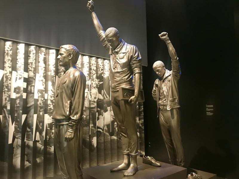 statues of black power salute olympians