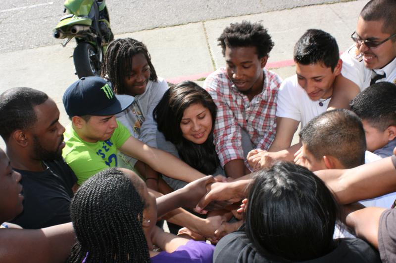 Alonzo with young people at fellowship placement