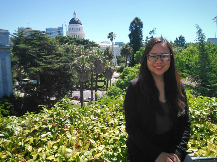 Lydia Wang on CRS balcony with state capitol building in background