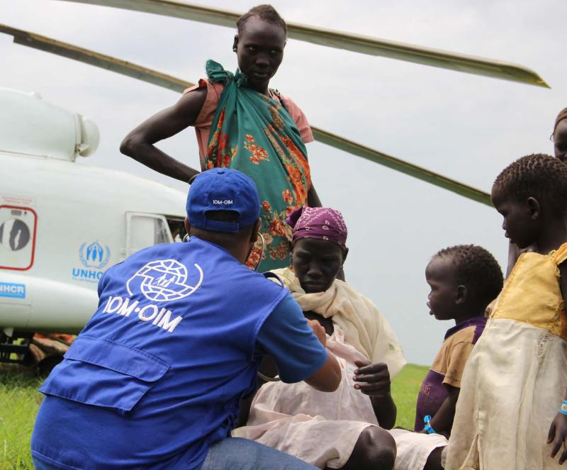 refugees in Sudan being assisted by IOM staff