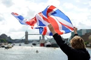person waving British flag at London Bridge