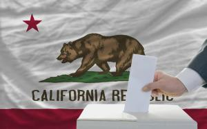 ballot box with California flag in background