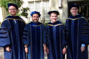 John Brooks, Greg Elinson, Stephen Goggin and Doug Ahler in graduation regalia