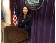 Washington Matsui Fellow Yixi Zhao posed at the podium of Department of Defense at the Pentagon, Washington, D.C.
