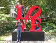 "In front of the iconic ""LOVE"" statue at the University of Pennsylvania campus."