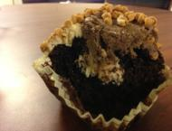 Crumbs: A perfect mix of peanut butter frosting and chips, chocolate cake and cream cheese blends together to form this half-eaten Baba Booey cupcake.