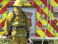 A firefighter stands at the ready during a June training burn on the Parkway.