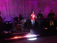 A networking event in the Raza community with live Spanish rock.