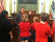 Assemblyman Wieckowksi explaining to kids what happens on the Assemby floor.