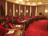 Young Senators in senate chambers awaiting the start of their floor session
